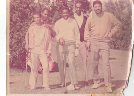 Grandfather MJ Bynum (center) and his golf buddies